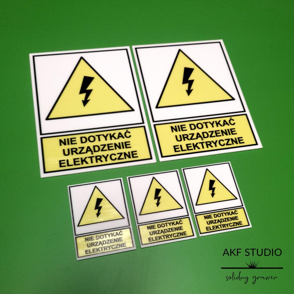 tabliczka nie dotykac urzadzenie elektryczne